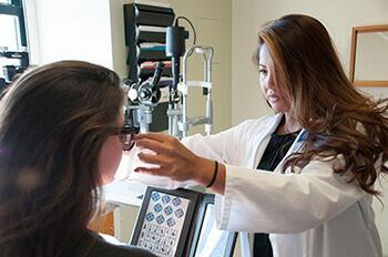 Woman receiving an Eye Exam