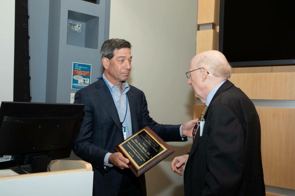 Dr Duker handing an award